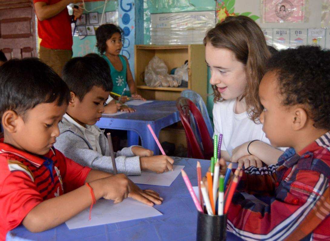A Projects Abroad volunteer assists at a community-based care placement rather than orphanage volunteer work.